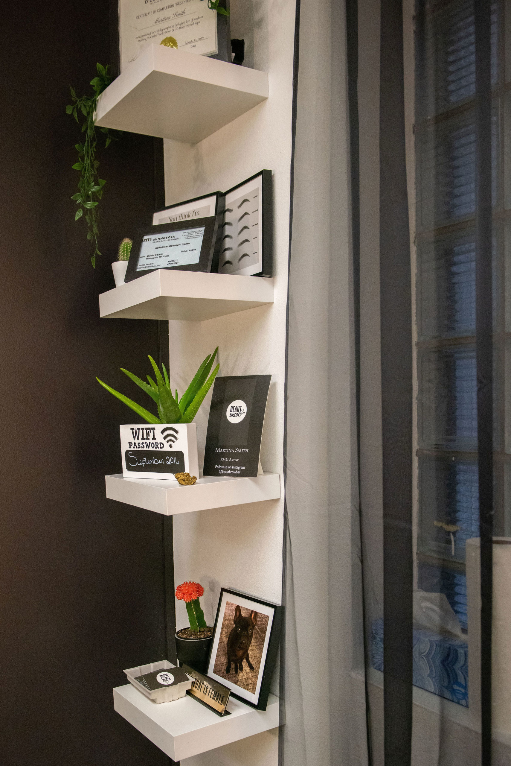 wall shelf with plants, pictures and knick knacks