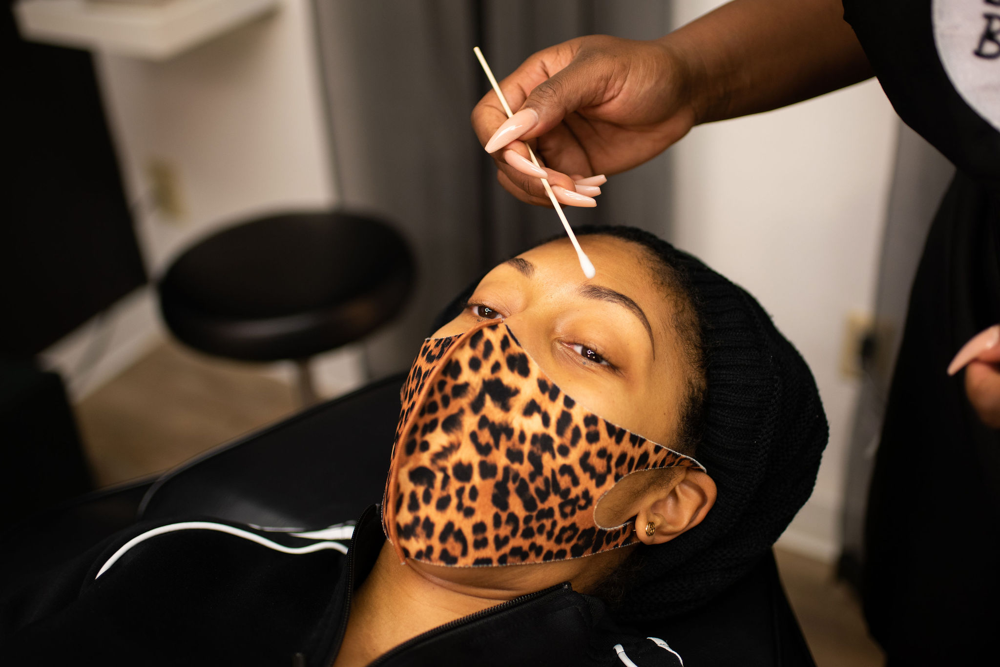owner applying lotion to brows after treatment